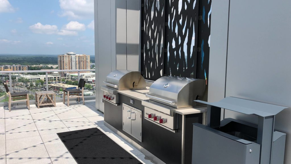 cooking out on the roof at 930 Pike and Rose condo